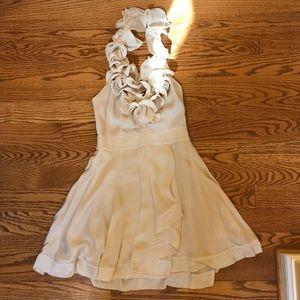 100% silk Bebe halter dress with lining.